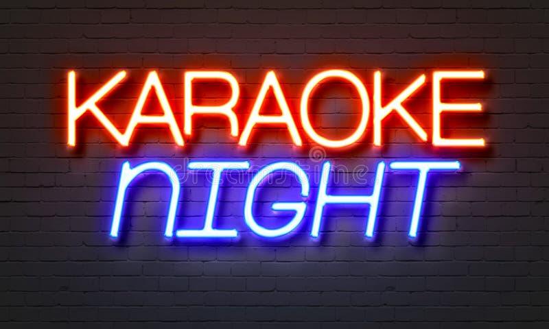 在砖墙背景的卡拉OK演唱夜霓虹灯广告 库存照片
