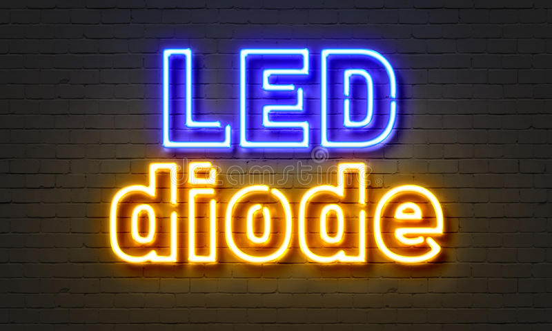 在砖墙背景的LED二极管霓虹灯广告 免版税库存照片