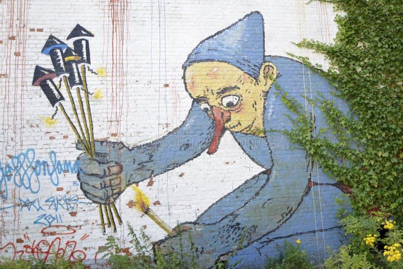 在砖墙, Doel,比利时上的街道画 库存例证