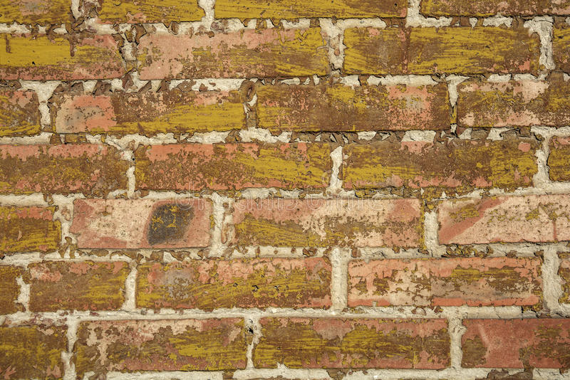 在砖的老油漆 免版税库存照片