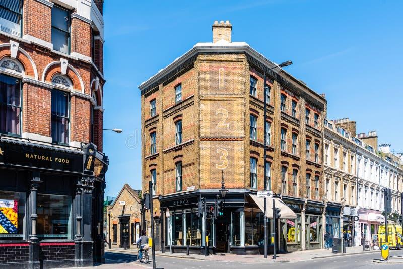 在砖车道,Shoreditch,伦敦的街道场面 免版税图库摄影