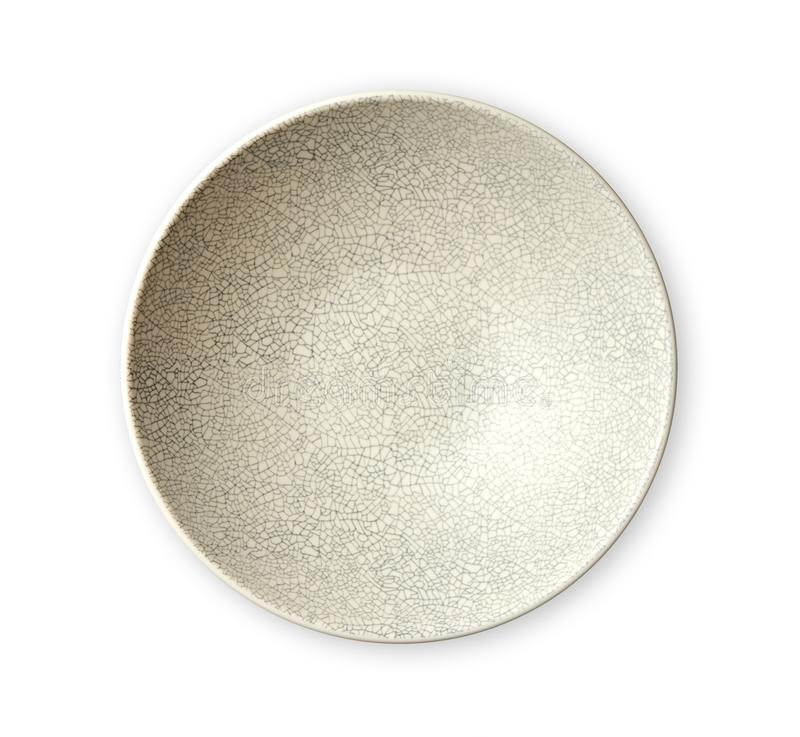 在破裂的样式,空的象牙板材,看法的现代东方陶瓷板材从上面隔绝在白色背景 库存照片