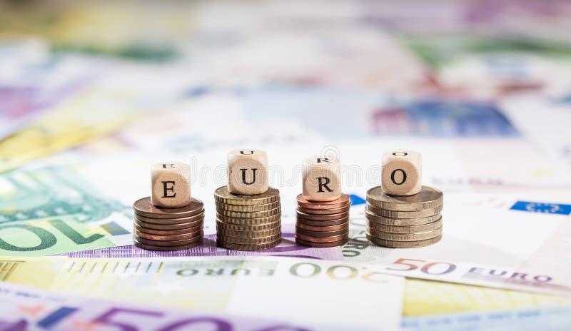 在硬币堆的词欧元,现金背景 图库摄影