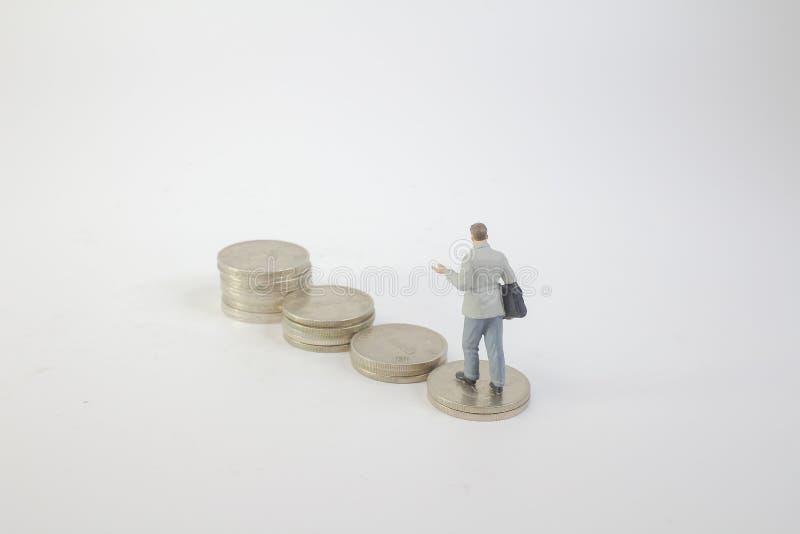 Download 在硬币的微型企业形象立场 库存照片. 图片 包括有 事业, 编号, 商业, 收入, 权限, 玩偶, 比较 - 115209964