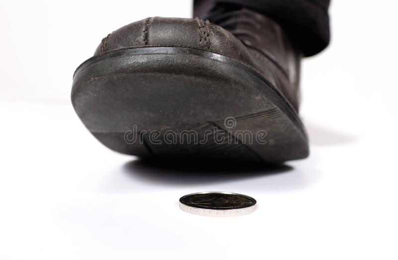 在硬币的步 库存照片