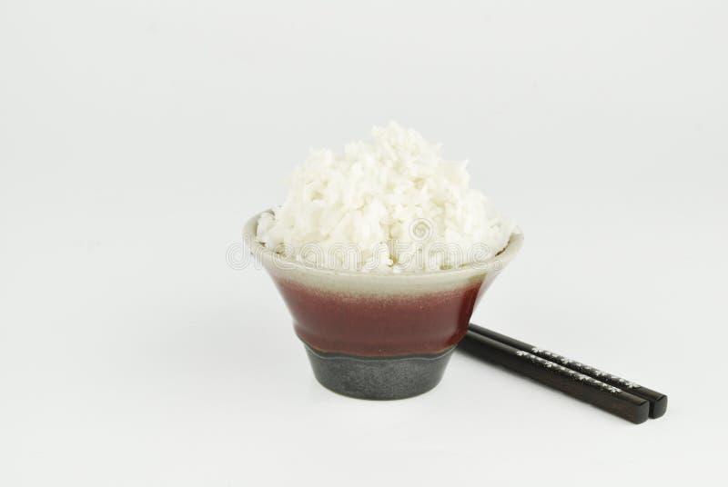 在碗和筷子的米 免版税图库摄影