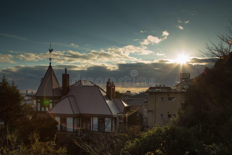 在神户风标房子的日落 库存照片