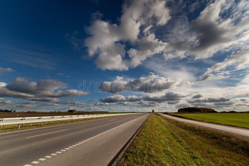 在秋天的高速公路在立陶宛 库存照片