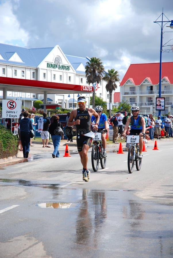 在种族的Ironman triathlete 免版税库存照片