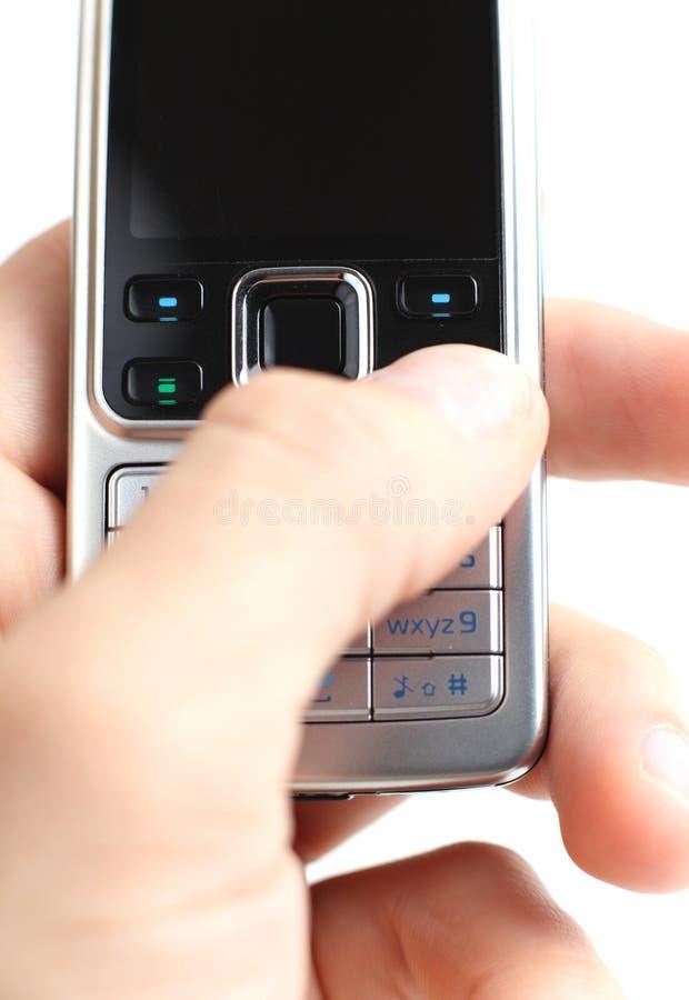 在移动电话的Texting 库存图片