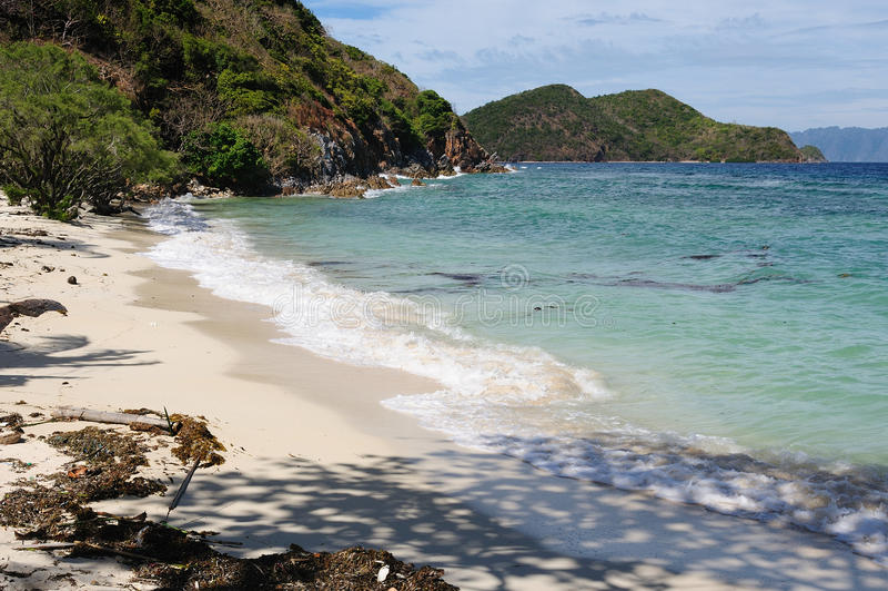 在空白沙子海滩的美丽的景色 免版税库存图片