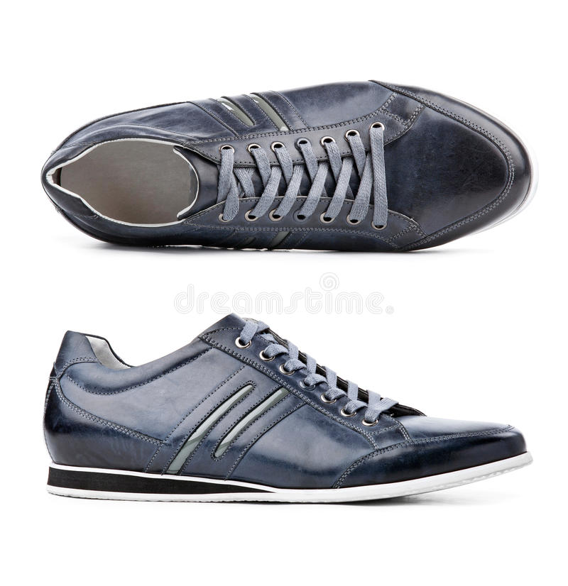 在空白的鞋子的男 免版税图库摄影