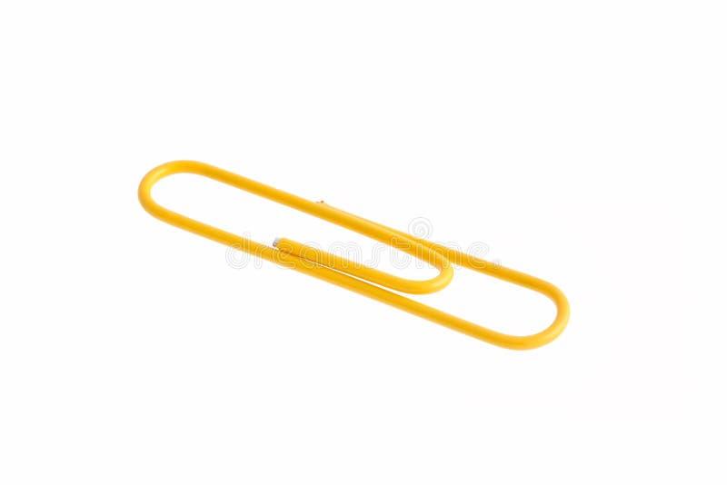 在空白背景查出的黄色回形针 免版税库存照片