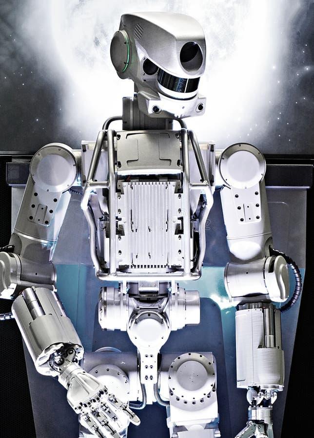在空间背景的金属机器人 免版税图库摄影