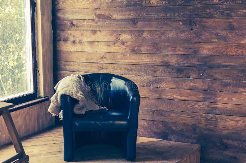 在窗口附近的舒适的扶手椅子 库存照片