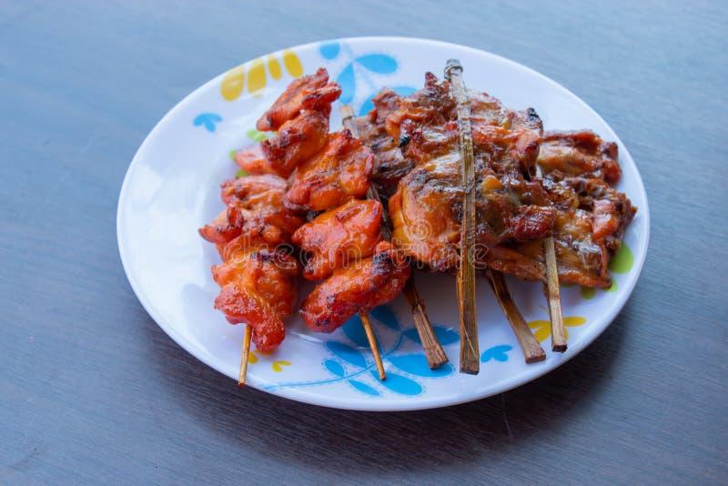 在竹子的烤鸡 免版税库存图片