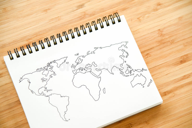 在笔记本的世界地图概述 库存照片