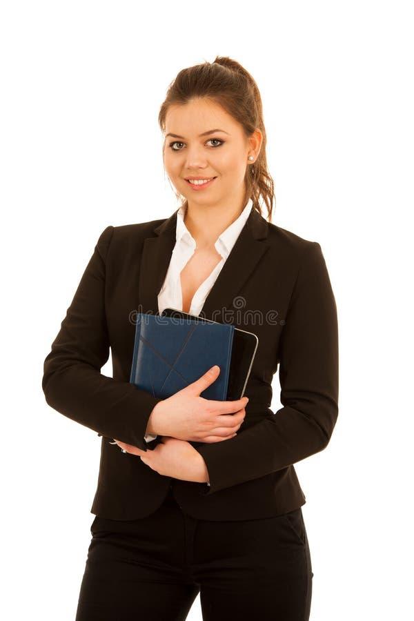 在笔记本的妇女文字被隔绝在白色背景 免版税库存照片