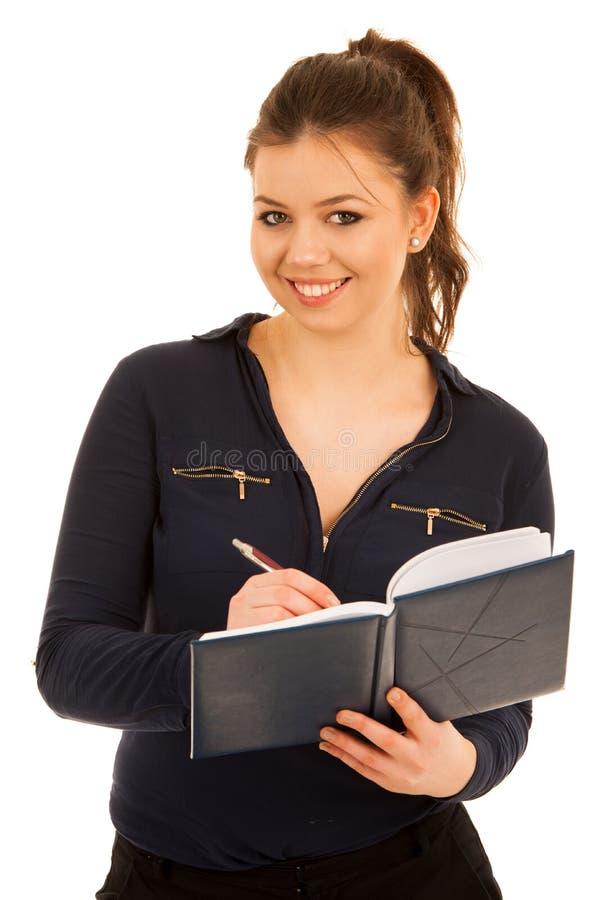 在笔记本的妇女文字被隔绝在白色背景 免版税图库摄影