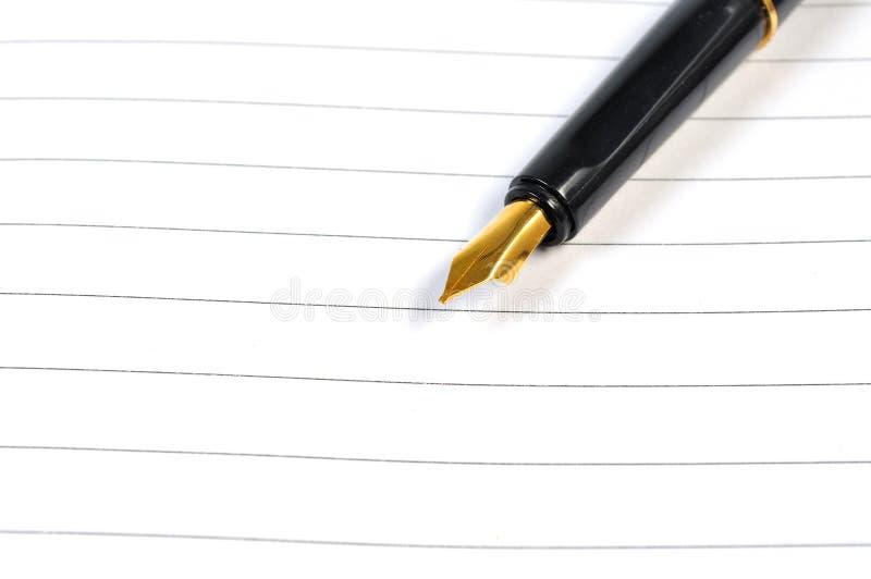 在笔记本的钢笔 库存照片