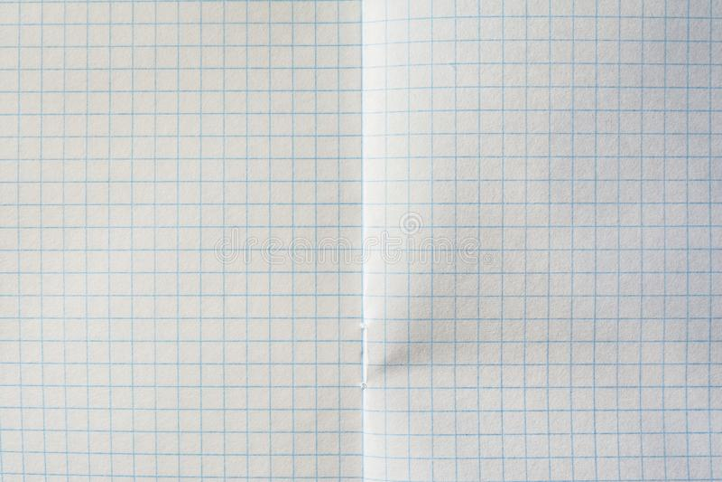 在笼子的笔记本板料,在两页笼子的纹理笔记本  图库摄影