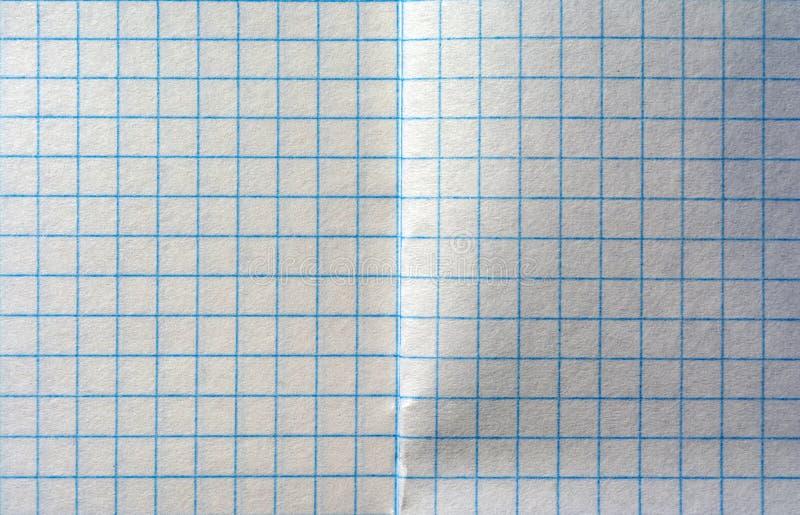 在笼子的笔记本板料,在两页笼子的纹理笔记本  库存照片