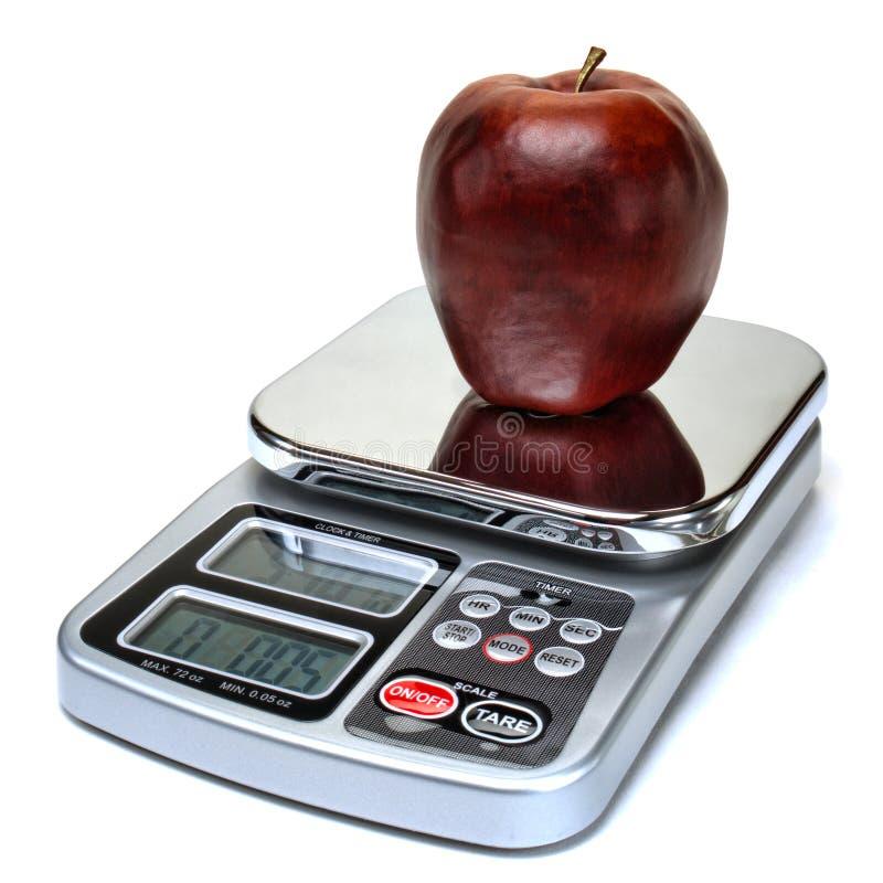 在等级的苹果计算机果子计数饮食的卡路里的 图库摄影