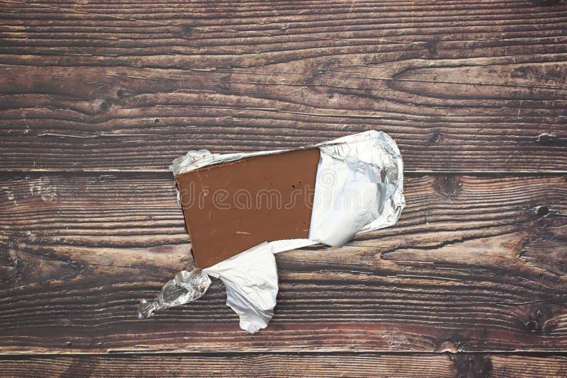 在箔的巧克力在桌上 库存照片