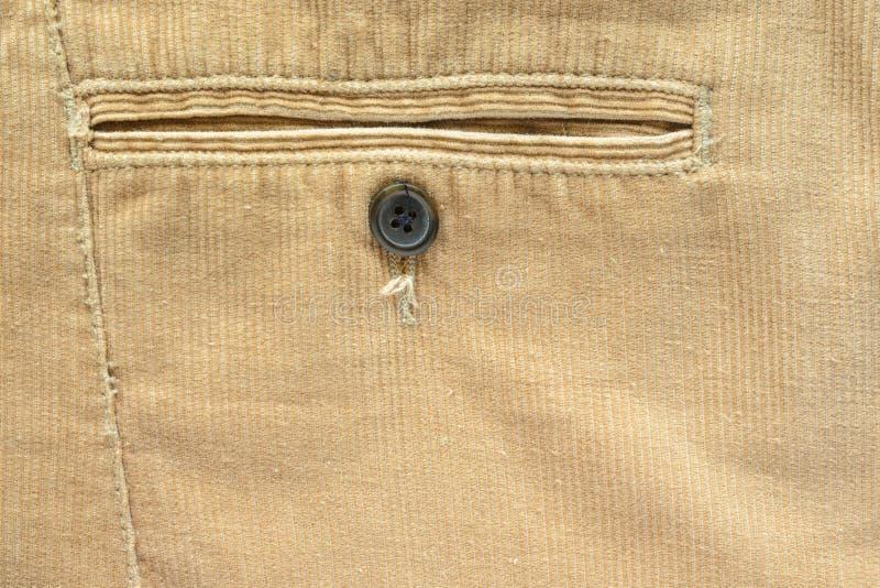 在米黄天鹅绒裤子特写镜头的口袋 图库摄影