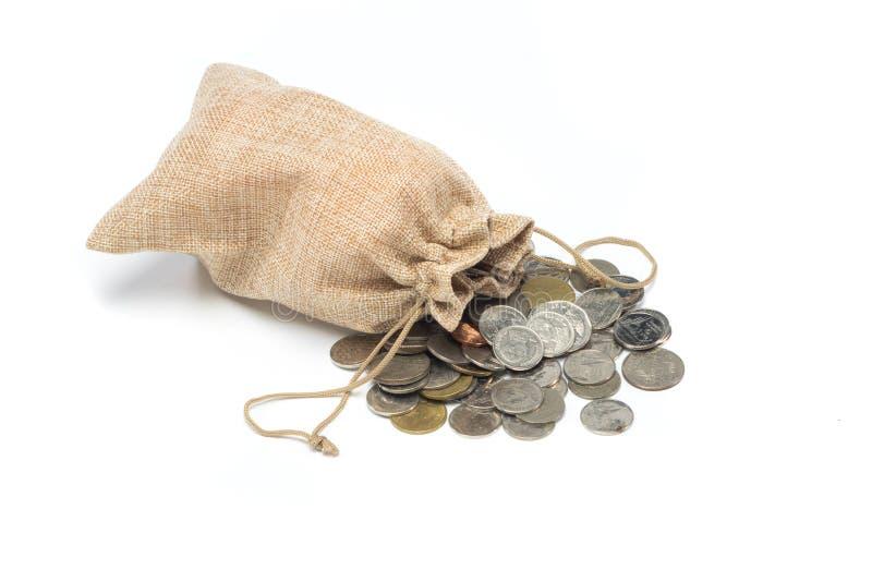在粗麻布袋的金钱硬币 库存照片