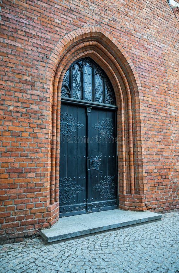 在红砖墙壁的中世纪进口 免版税库存图片