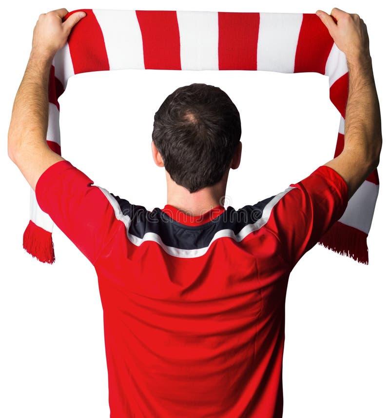 在红色举行的围巾的足球迷 免版税库存照片