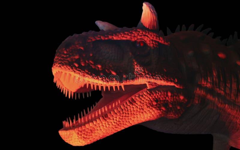 在红色和黑色的食肉食肉牛龙恐龙 免版税图库摄影