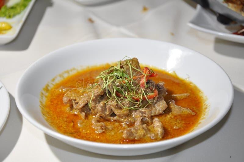 在红色咖喱的牛肉 库存照片