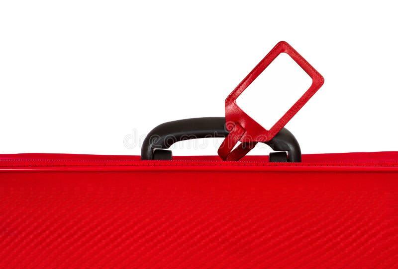 在红色手提箱标签白色的空白特写镜& 库存图片