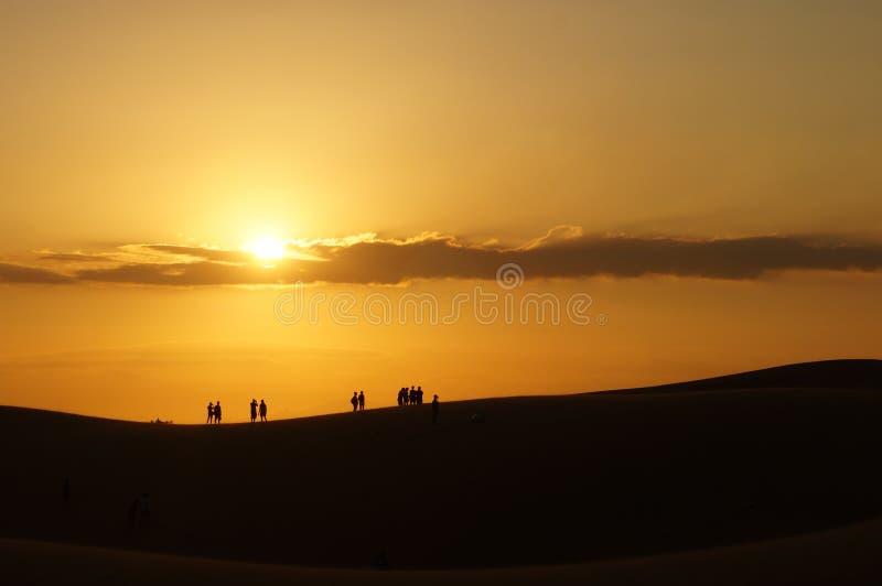 在红色沙丘美奈,藩切,越南的日落 图库摄影
