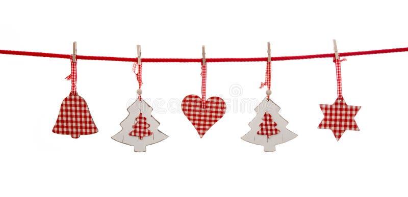 在红色白色的被隔绝的圣诞节装饰检查了颜色hangi 库存照片