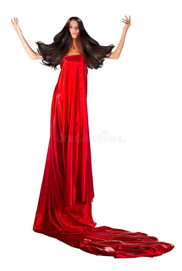 在红色礼服的Woma有壮观的头发的 库存照片