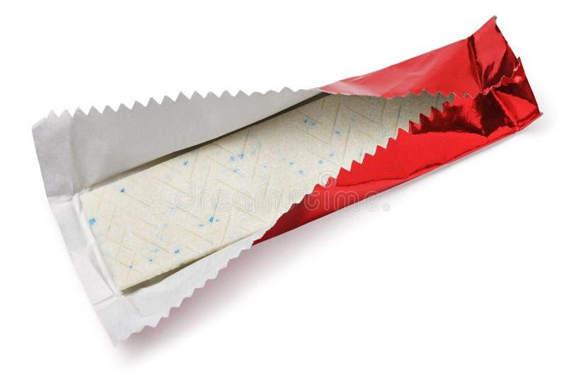 在红色箔的口香糖板材在白色 库存照片