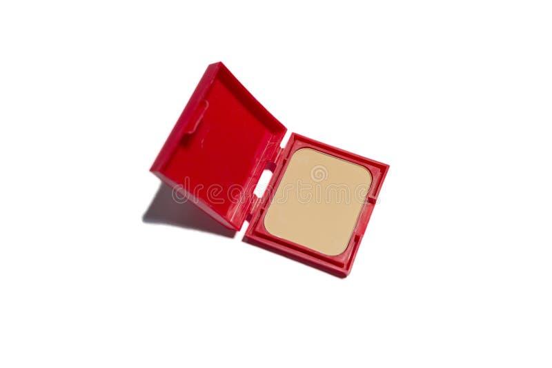 在红色紧凑箱子的基础粉末 库存照片