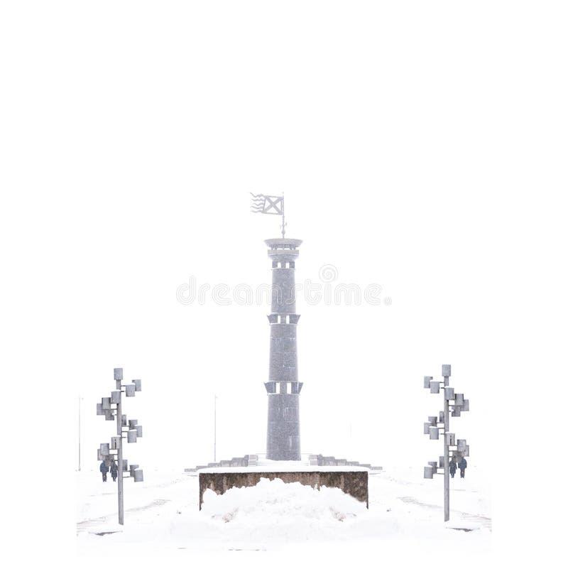 在纯净的白色背景隔绝的积雪的唯一灯塔 库存图片