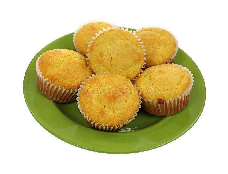 玉米粉小蛋糕绿色板材 库存图片