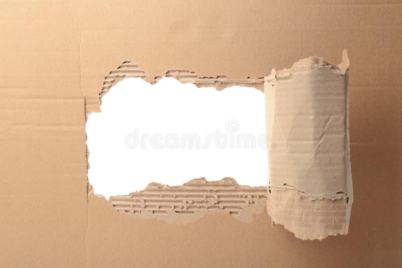 在纸板的孔在白色背景 免版税图库摄影