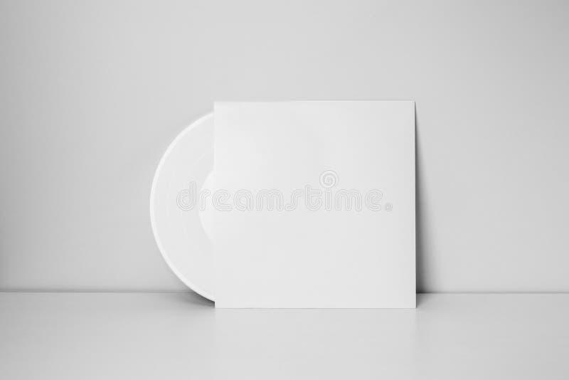 在纸案件的白色唱片 库存图片