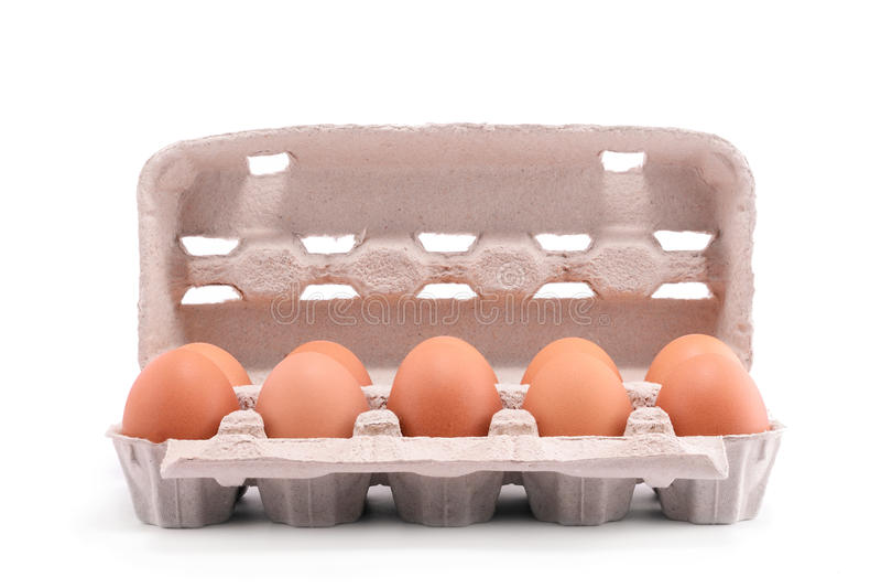 在纸盒包裹的十个新鲜的鸡蛋 库存图片