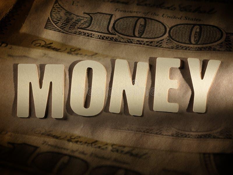 在纸背景的词金钱 库存照片
