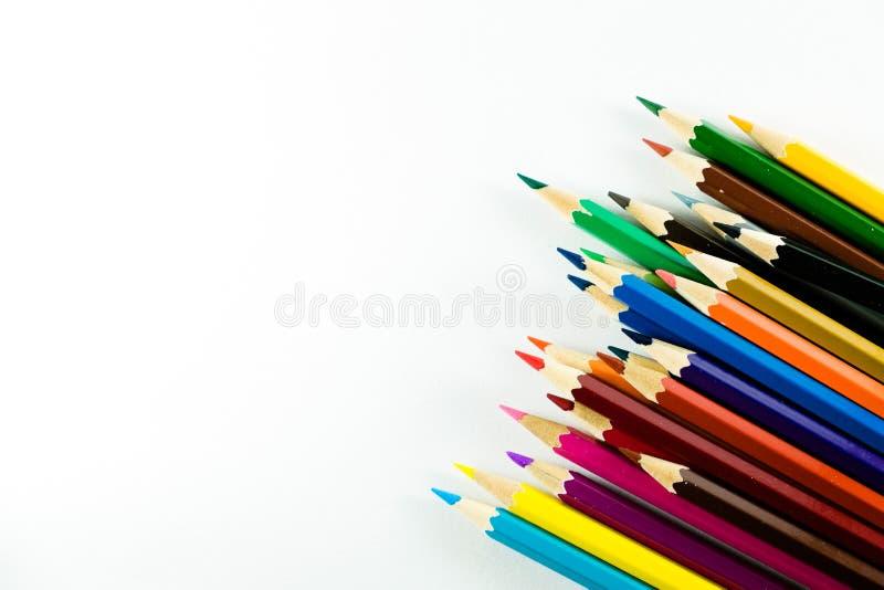在纸背景的颜色铅笔 库存图片