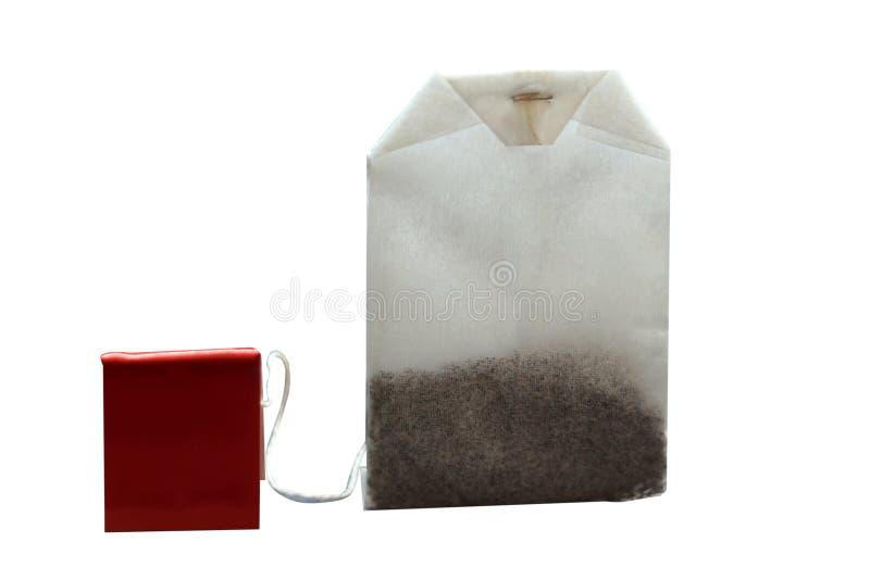 在纸袋的茶与红色标签 背景查出的白色 草本茶袋 免版税库存图片