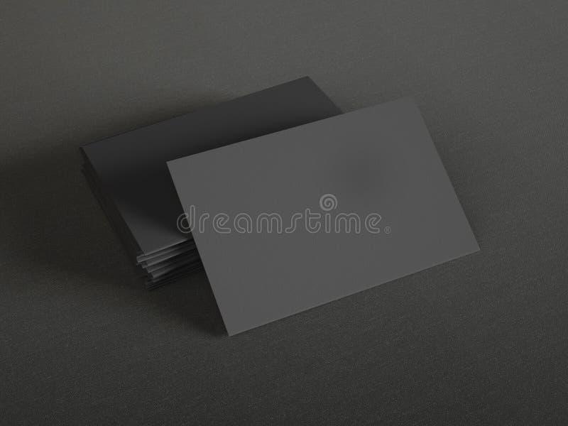 在纺织品背景的黑名片 库存照片