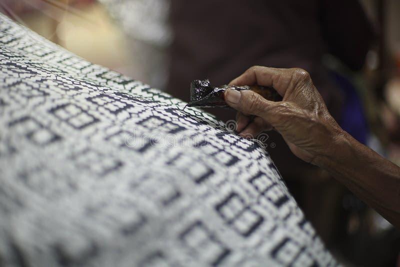 在织品的图画蜡染布 库存图片